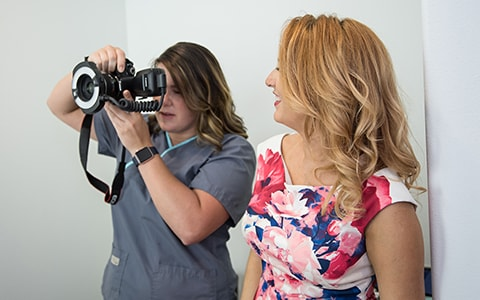 Tracy helping a fellow treatment coordinator how to use the camera as part of our orthodontic practice management services